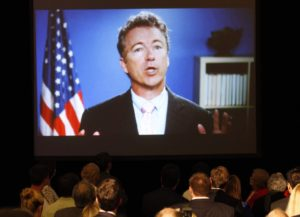 U.S. Senator Rand Paul (R-KY) is seen on a screen as he introduces U.S. Senate Republican Leader Sen. Mitch McConnell (R-KY) to a crowd of campaign supporters after McConnell defeated Tea Party challenger Matt Bevin in the state Republican primary elections in Louisville, Kentucky, May 20, 2014. (John Sommers II/Reuters)