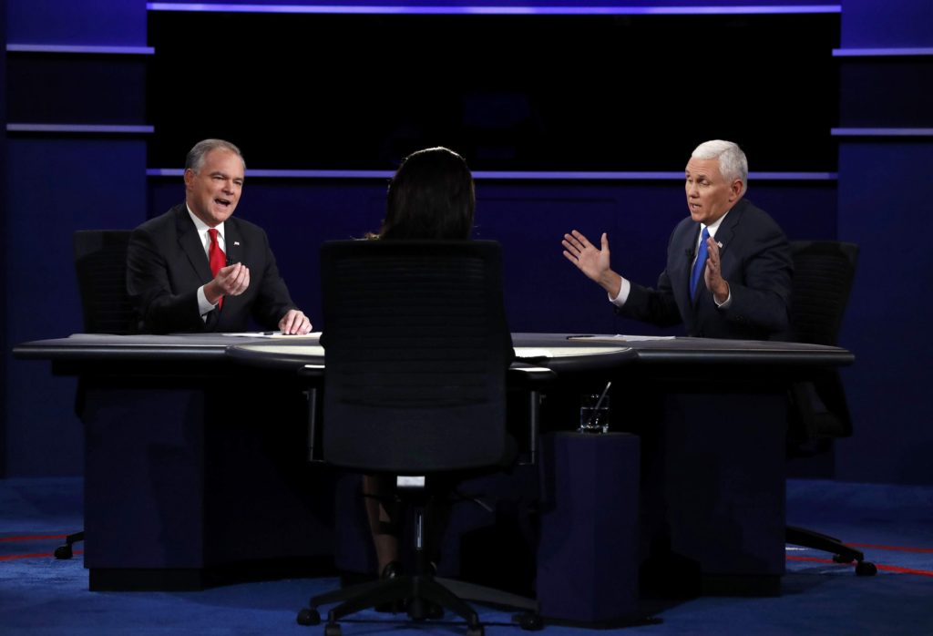Democratic U.S. vice presidential nominee Senator Tim Kaine (L) and Republican U.S. vice presidential nominee Governor Mike Pence discuss an issue as as moderator Elaine Quijano looks on during their vice presidential debate at Longwood University in Farmville, Virginia, U.S., October 4, 2016. REUTERS/Kevin Lamarque