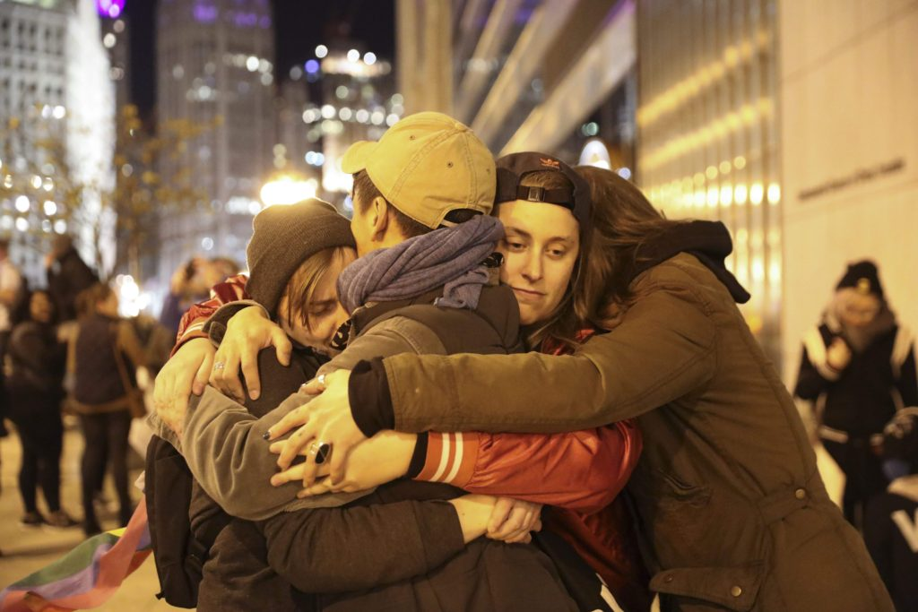 Protesters hug after attempting to cross the North Wabash Avenue bridge in downtown Chicago on Wednesday, Nov. 9, 2016. (Armando L. Sanchez/Chicago Tribune/TNS)