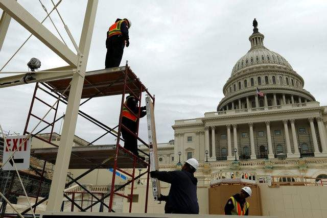 Workers construct the viewing stands ahead of U.S. President-elect Donald Trump's Jan. 20 inauguration at the U.S. Capitol in Washington, U.S., December 8, 2016. The Women's March on Washington will take place the morning of Jan. 21, with marchers meeting at the intersection of Independence Ave. and Third Street S.W., just a few blocks west of this inauguration site. (Jonathan Ernst/Reuters)