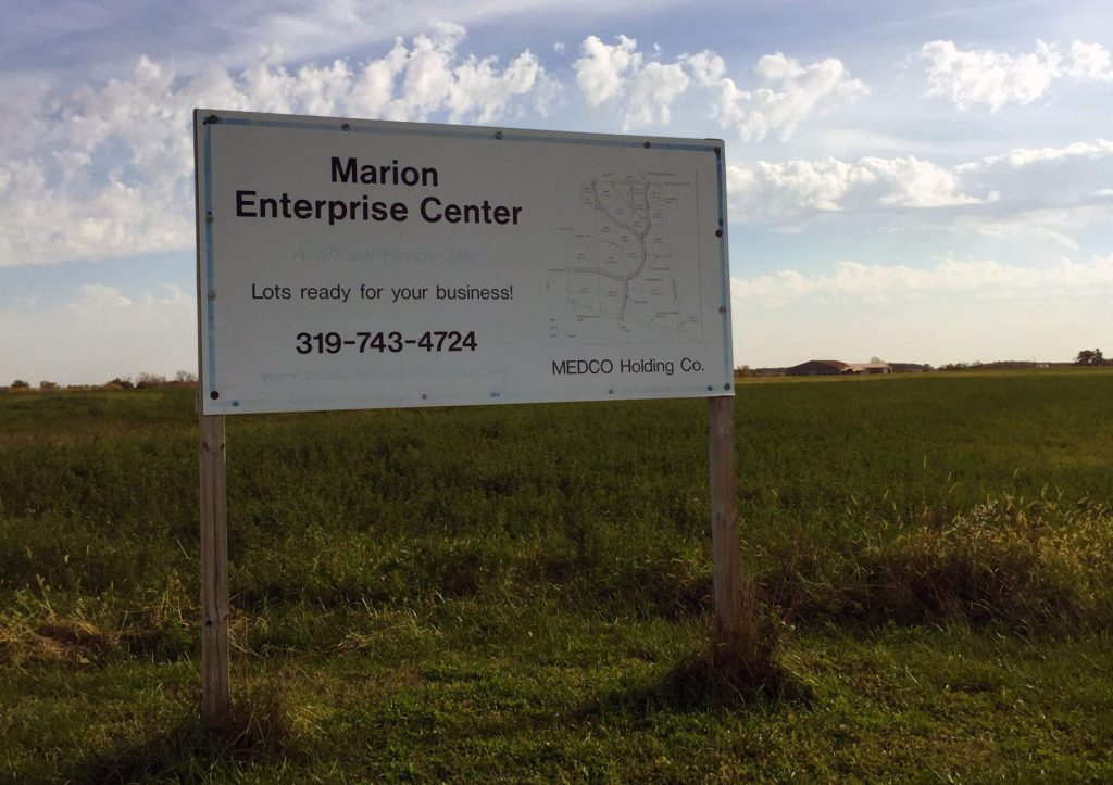 A sign promoting one of the vacant lots in the Marion Enterprise Center business and industrial park stands near the intersection of Partners Ave. and N. Gateway Dr. in Marion, Iowa on Nov. 1, 2016. Municipal and economic development leaders are exploring the possibility of expanding public transit services east to encompass this area. (Lynda Waddington/The Gazette)