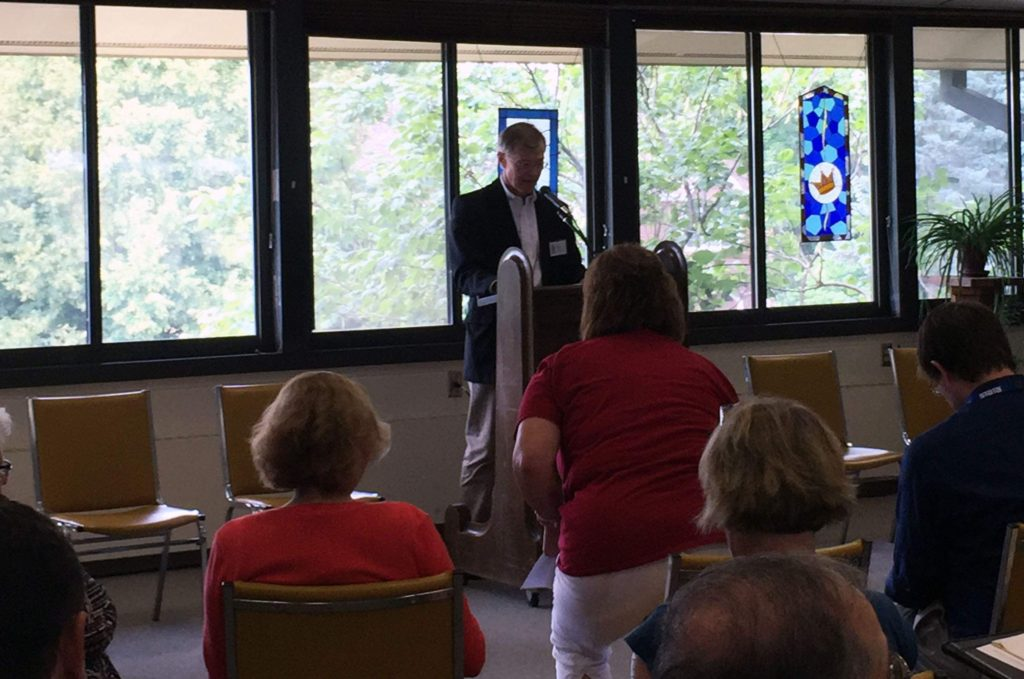 Ed Cranston with First Presbyterian Church Servanthood Ministry in Iowa City welcomed about 50 visitors to the church on Aug. 17, 2016 for a discussion on refugee assistance he jointly organized with Iowa Sen. Joe Bolkcom. (Lynda Waddington/The Gazette)