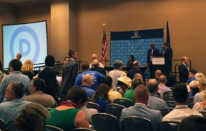 Democratic National Convention delegates attending the LGBT Caucus meeting on Tuesday, July 26, move toward their seats. The meeting began with a moment of silence for those harmed by the attack at Orlando's Pulse nightclub and all those touched by violence. (Lynda Waddington/The Gazette)