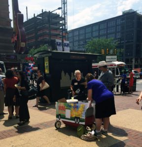 "Catholic sisters volunteering with ""Nuns on the Bus"" offered lemonade and pledge cards to people walking near the intersection of 12th and Market streets in Philadelphia on July 29, 2016, during the Democratic National Convention. (Lynda Waddington/The Gazette)"