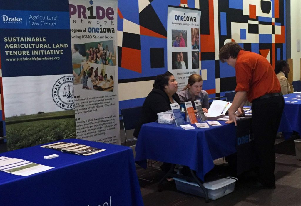 One Iowa volunteers speak with an attendee of the LGBT Rural Summit at Drake University in Des Moines on Thursday, Aug. 18, 2016. One Iowa partnered with Drake, the National Center for Lesbian Rights, the True Colors Fund and the USDA to host the event geared toward equality across rural America. Nationally, Iowa is the 13th of 15 planned summits. (Lynda Waddington/The Gazette)