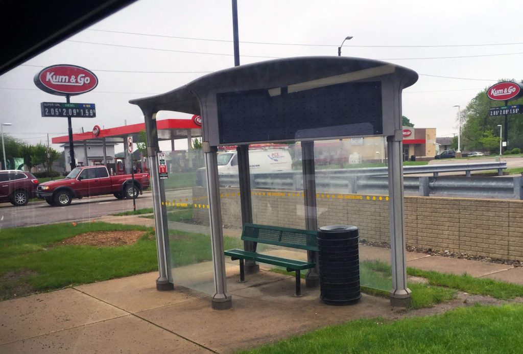 The bus stop on First Avenue NE near 32nd Street NE is viewed out the window of a Cedar Rapids transit bus on May 10, 2016. The shelter is part of a two-year-old public-private partnership. The advertising company provided and maintains the structure and keeps revenue from advertising. (Lynda Waddington/The Gazette)