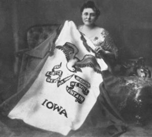 Dixie Cornell Gebhardt of Knoxville, Iowa, was originator of this flag design that in March 1921 was accepted by the Iowa legislature as the official Iowa state flag. Gebhardt was born on Nov. 18, 1866, in Knoxville, and lived most of her life in Iowa. She died on Oct. 16, 1955, at age 88. Her grave was marked by the Daughters of the American Revolution (DAR) as the designer of the flag. Photo 1921.