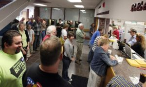 Long lines at the Johnson County Auditor's Office have historically been attributed to the first day of early voting, like this 2010 file photo depicts. On July 17, however, the Auditor's Office will begin accepting applications for Community ID cards. Johnson County is the first community in Iowa and in the Midwest to begin the practice. (Brian Ray/The Gazette)