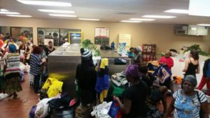 People gather at the 7-11 Laundromat on 11th Street in Rock Island, Ill. to participate in Laundry Love QC. A volunteer group of about 10 people are providing one free laundry night each month at this site and Davenport's Laundromania. Local advocates say a need exists in the Creative Corridor as well. (Photo courtesy facebook.com/laundryloveqc)