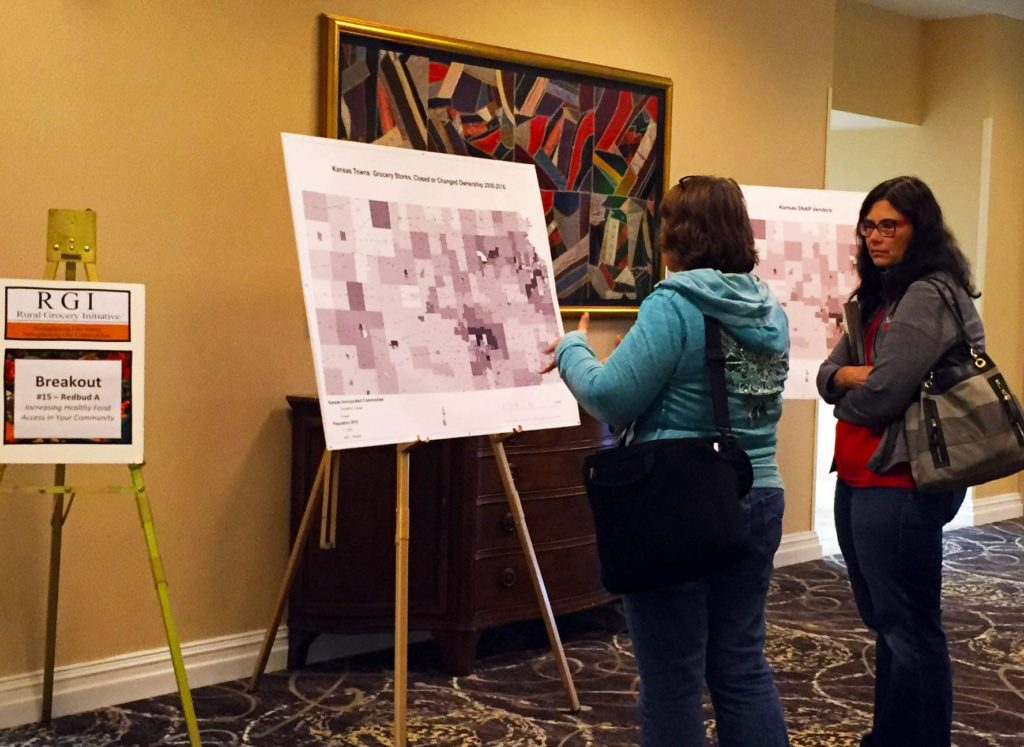 Attendees of the fifth Rural Grocery Summit in Wichita, Kan. viewed posters showing Kansas food deserts, grocery store ownership and closures and regional food council information. The graphic series was developed by the Rural Grocery Initiative, Kansas State University. Live Healthy.