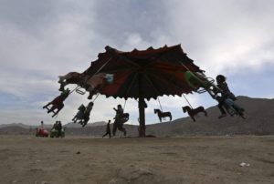 Grateful Life - Afghan children play on a swing at an old part of Kabul in 2014.