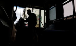 A passenger on the Route 5S bus pays his fare as he gets on the bus stop at Lindale Mall in northeast Cedar Rapids, Iowa, on Tuesday, May 3, 2016. The bus travels from the Cedar Rapids Ground Transportation Center to the Marion Walmart then back to the GTC.