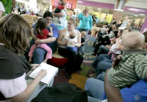 """Several dozen people showed up at Lindale Mall in Cedar Rapids in the spring of 2010 for a """"Nurse-In"""" after a local woman was confronted about breastfeeding in public by a security guard. Although Iowa law protects the rights of breastfeeding mothers to feed their children, some Iowans still attempt to stop the practice. (Julie Koehn/The Gazette)"""