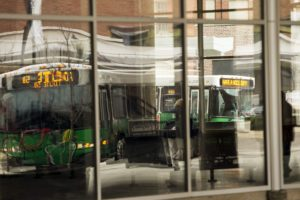 CR Transit buses are reflected in the windows of the Ground Transportation Center on Monday, Dec. 2, 2013, in Cedar Rapids. (Liz Martin/The Gazette)