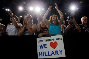 Audience members cheer while U.S. Democratic presidential candidate Hillary Clinton speaks at a campaign rally in Tampa, Florida on July 22, 2016..
