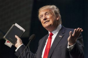 U.S. Republican presidential candidate Donald Trump holds his bible while speaking at the Iowa Faith and Freedom Coalition Forum in Des Moines, Iowa, September 19, 2015.