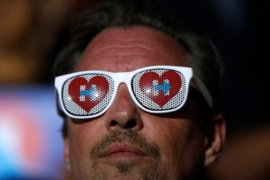 A supporter wears a sunglasses adorned with logos of Democratic U.S. presidential candidate Hillary Clinton during a campaign event on May 26, 2016.
