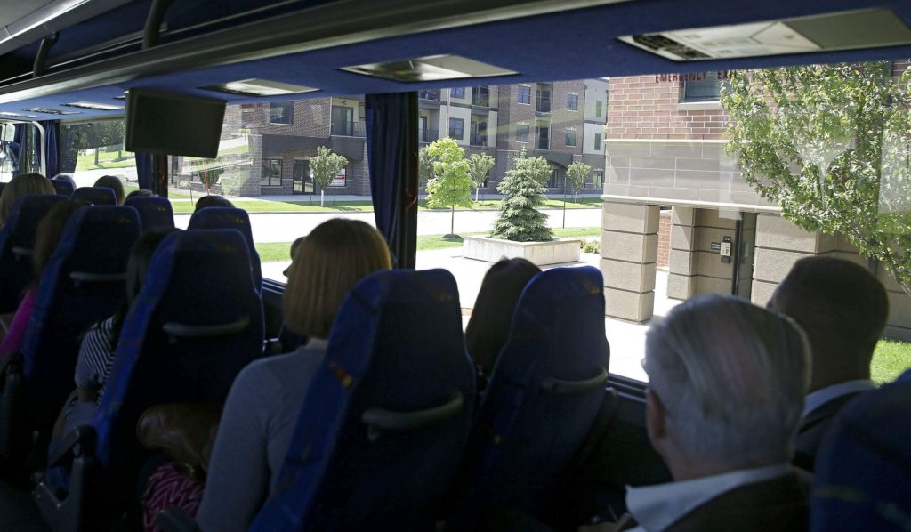 People look at the Oakhill Jackson Brickstones during the Cedar Rapids Metro Affordable Housing Bus Tour in Cedar Rapids on Thursday, May. 25, 2017. The project, according to the tour guide, was an $18 million investment in the community.