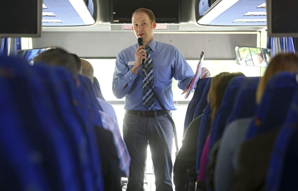 Jeff Capps, Executive Director of Cedar Valley Habitat for Humanity, serves as tour guide during the Cedar Rapids Metro Affordable Housing Bus Tour in Cedar Rapids on Thursday, May. 25, 2017.