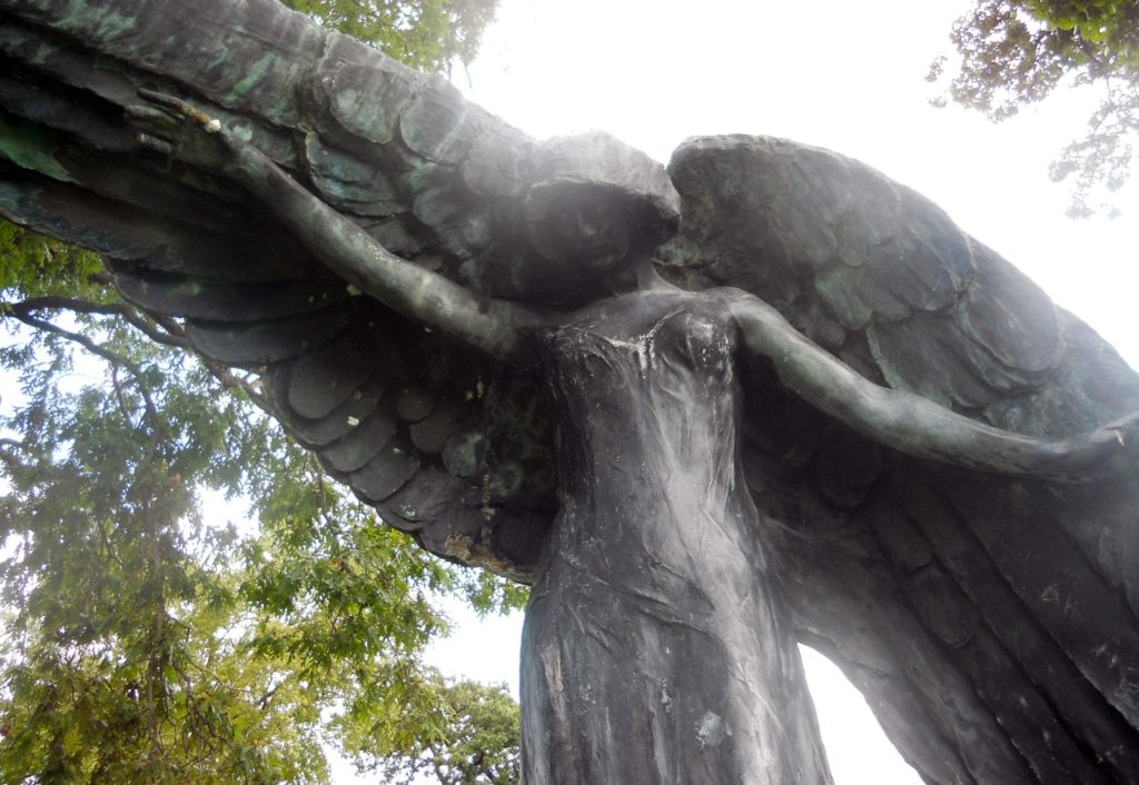 The black angel in Iowa City's Oakland Cemetery stands eight-feet over the graves of the Feldevert family. Shrouded in folk lore, the angel is regularly visited by those willing to tempt fate. (Lynda Waddington/The Gazette) - Iowa Culture
