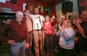 Jim Throgmorton, John Thomas, Rockne Cole and Pauline Taylor celebrate their election to the Iowa City City Council during a campaign party for the Core Four group at The Sanctuary Pub, in Iowa City, Iowa, on Tuesday, Nov. 3, 2015.