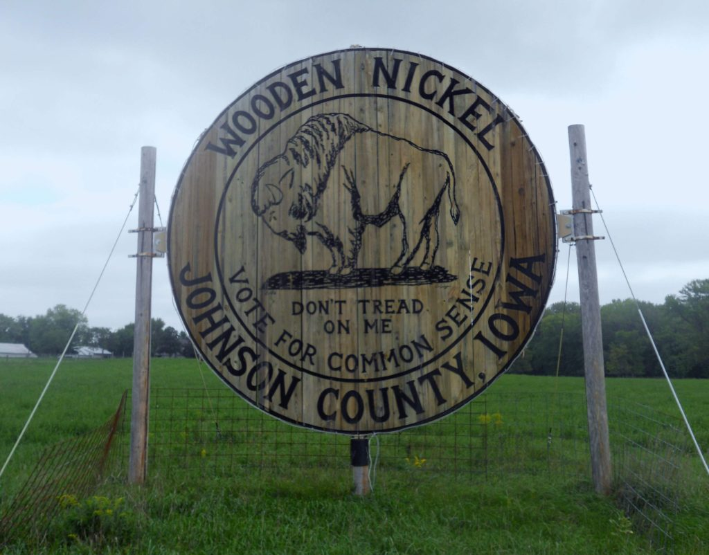 Located alongside Dubuque Street in Johnson County this wooden Nickel has stood in protest of local government since 2006, when county supervisors raised speed limits in the area. (Lynda Waddington/The Gazette) - Iowa Culture app