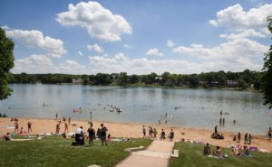Beach goers swim in the waters of Lake Macbride near Solon.