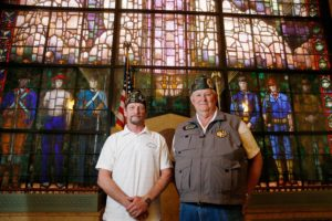 Linn County Veterans Charity Fund Chairman Ron Williams (right) and U.S. Army Vietnam War Veteran Curtis Goodrow of Cedar Rapids stand in front of the Veterans Memorial Window at Veterans Memorial Building in Cedar Rapids on Tuesday, April 19, 2016.