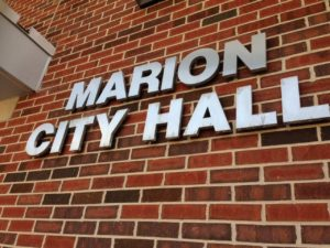 Lettering on the brick facade of Marion City Hall in Marion, Iowa.