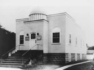 "Cedar Rapids, city of. Islamic Center (Mosque). Called the ""Mother Mosque"" by local Islamic scholar T.B. Irving, this small building at 1335 Ninth Street (9th St.) NW, was constructed in 1934 and is believed to be the oldest mosque built for that purpose in North America. A sign to the left of the front door reads, ""Moslem Temple."" A restoration project on the building was completed in February, 1992. Photo circa 1934."