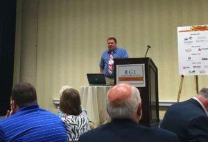 Nick Graham, who owns grocery stores and other businesses in the small Iowa communities of Rolfe, Ackley and Rockwell, gives the keynote address at the fifth Rural Grocery Summit in Wichita, Kan. on June 6, 2016.