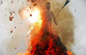 "The Boeoegg, a snowman made of wadding and filled with firecrackers, burns atop a bonfire in the Sechselaeuten square in Zurich. As the bells of St. Peter's church chime six o'clock, the bonfire below the ""Boeoegg"" is set alight and mounted guildsmen gallop around the pyre to the tune of the Sechselaeuten March. The faster the head of the ""Boeoegg"", the symbol of winter, catches fire and explodes, the warmer and more beautiful the summer will be."