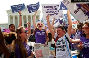 Demonstrators celebrate at the U.S. Supreme Court after the court struck down a Texas law imposing strict regulations on abortion doctors and facilities that its critics contended were specifically designed to shut down clinics in Washington, U.S. June 27, 2016.