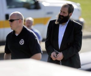 Federal agents escort Sholom Rubashkin, former manager of the Agriprocessors plant in Postville, into Federal Court for his initial appearance in Cedar Rapids on Thursday, Oct. 30, 2008. Rubashkin faces federal charges of conspiracy to harbor illegal aliens for financial gain, aiding and abetting document fraud and aiding and abetting aggravated identity theft, according to documents filed in the case.