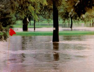 Greens on the Number 9 hole (red flag) and on Number 18 (white flag) are submerged at Saint Andrews Golf Couse in Cedar Rapids during the 1993 floods. July 5, 1993. Saint Andrews is a privately-owned public golf course.