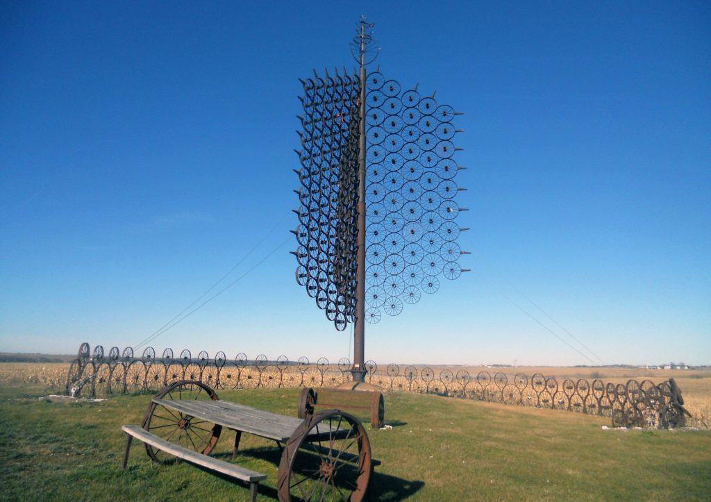 This treelike sculpture made from more than 200 steel wagon wheels is located south of I-80, north of the town of Sully. It was created by Leonard J. Maasdam, an 87-year-old area sorghum farmer and inventor. (Lynda Waddington/The Gazette) - Iowa Culture