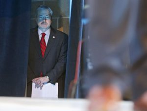 Gov. Terry Branstad (from left) waits backstage as Bruce Rastetter, host of the 2015 Iowa Ag Summit, talks during the 2015 Iowa Ag Summit at the Elwell Family Food Center on the Iowa State Fairgrounds in Des Moines on Saturday, Mar. 7, 2015.