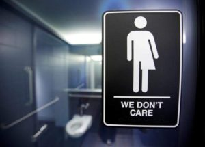 A sign protesting a recent North Carolina law restricting transgender bathroom access is seen in the bathroom stalls at the 21C Museum Hotel in Durham, North Carolina May 3, 2016.