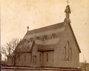 The original Trinity Episcopal Church sanctuary was built 1871 on the corner of Gilbert Street and College Street.