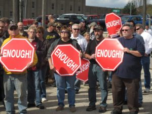 Correctional officers, many of them AFSCME members, demonstrate outside the Iowa State Penitentiary in Fort Madison against budget cuts in this file photo.