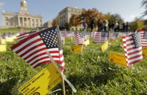 "American flags were placed in the shape of an ""I"" on the Pentacrest lawn at the University of Iowa in honor of veterans with Iowa ties in 2013. The project was a collaborative effort by area high school students and UI students, faculty and staff."