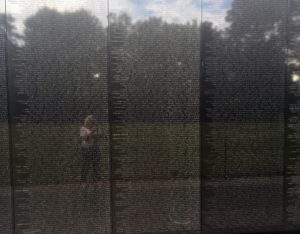 The reflection of columnist Lynda Waddington can be seen as she takes a photograph of the National Vietnam Memorial in Washington, D.C. (Lynda Waddington/The Gazette)