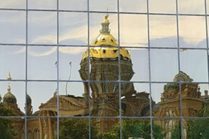 The Iowa State Capitol building is reflected in the windows of the Wallace State Office building in Des Moines on Wednesday, July 29, 2015. (Stephen Mally/The Gazette)