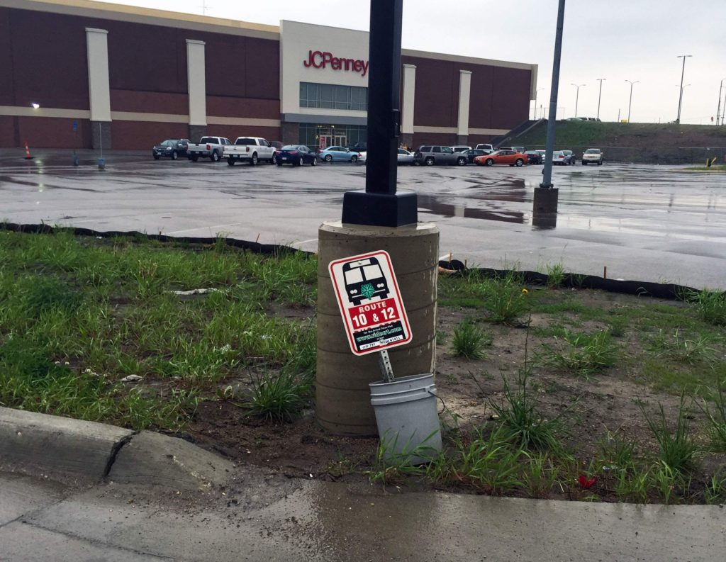 Construction in the area surrounding Westdale Mall is largely to blame for the state of this bus stop, which services Cedar Rapids Transit Routes 10 and 12. (Lynda Waddington/The Gazette)