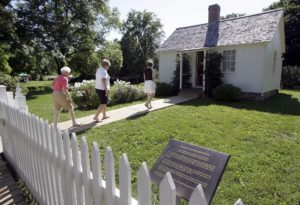 National Monuments - Tourists walk into the small two room cottage where President Herbert Hoover was born during Hooverfest Saturday, Aug. 2, 2008 in West Branch. The cottage is part of the Herbert Hoover National Historic Site and Presidential Library and Museum.