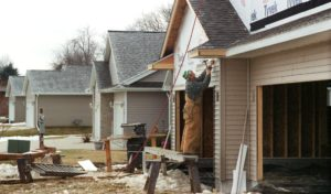 Siding is added to new housing development. (File photo)