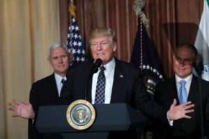 U.S. President Donald Trump speaks while flanked by Vice President Mike Pence (L) and EPA Administrator Scott Pruitt prior to signing an executive order eliminating Obama-era climate change regulations, during an event at Environmental Protection Agency headquarters in Washington, U.S., March 28, 2017.