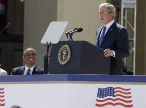President George W. Bush addresses the dedication of the George W. Bush Presidential Center as President Barack Obama (L) listens during the ceremony on the campus of Southern Methodist University in Dallas, Texas April 25, 2013.