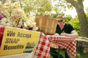 Food - A Mount Vernon farmer's market vendor advertises acceptance of SNAP benefits in this 2012 file photo.