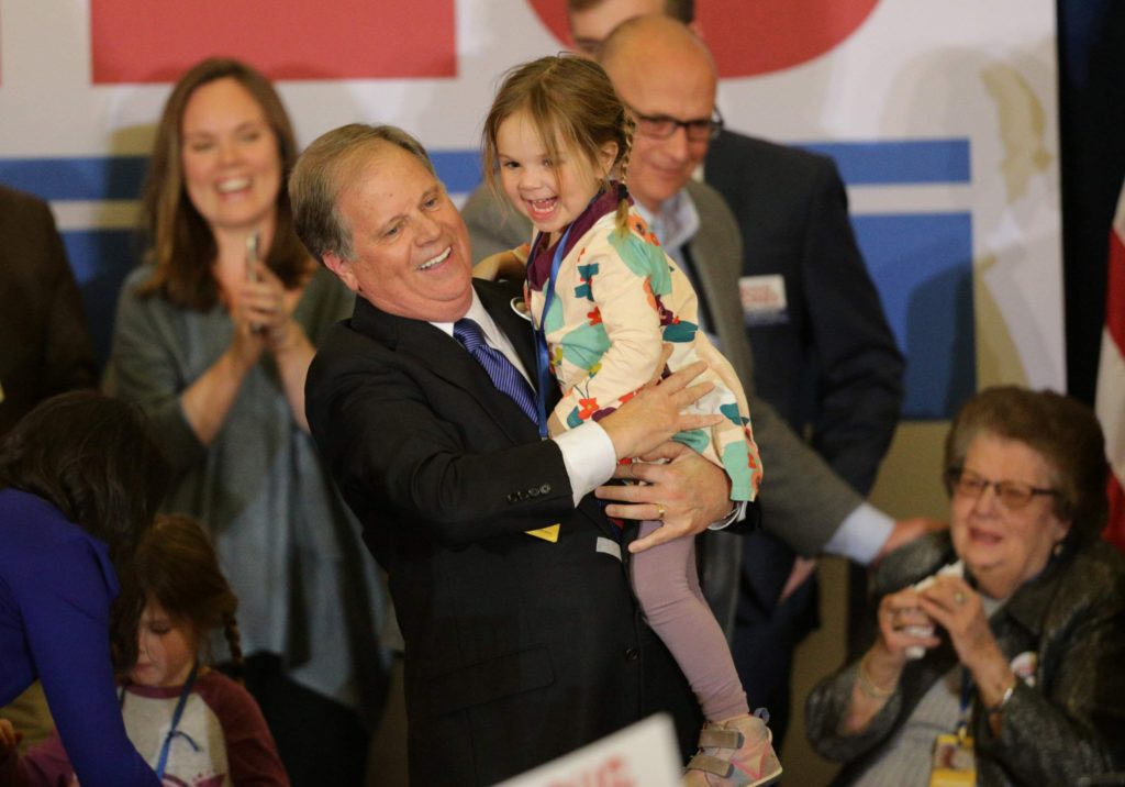 Pro-Life - Democratic Alabama U.S. Senate candidate Doug Jones holds his granddaughter as he celebrates with supporters at the election night party in Birmingham, Alabama, U.S., December 12, 2017.